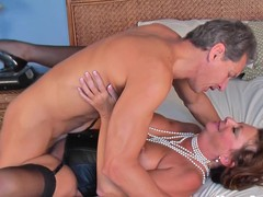 Mature Margo rides cock in a pearl tassel