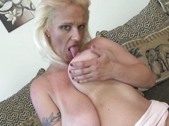 blonde mature loves her breasts