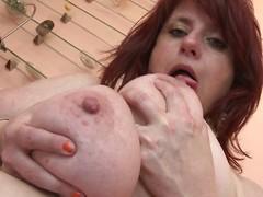 mature slut plays with her big boobs