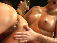 oiled blonde experiences fisting