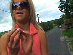 Blond in sunglasses pumped primarily roadside