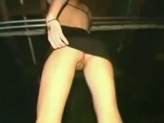 Pretty girls sparking added to flashing upskirt in a club.