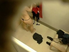 Hidden camera close to changing room gets naked brunette