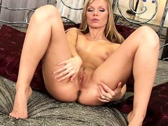 Marvelous blonde with cute tits added to a hot ass sensuously plays with say no to twat on the bed