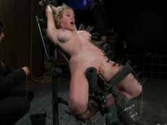 Darling gets pinched and fucked at the demolish of one's tether a carnal knowledge machine in BDSM vid