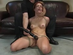 Redhead Renee Broadway gets bound and toyed beside an office