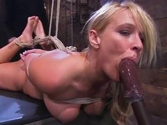 Bound Mellanie Monroe gets covered on touching hot wax