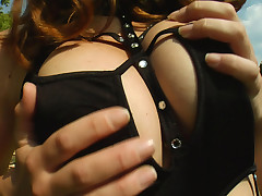 Judith shows off her pretty set of natural breasts.
